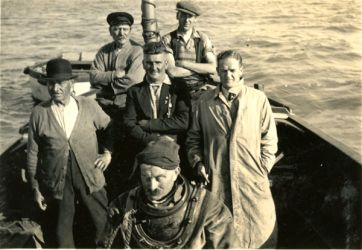 Group on boat with diver