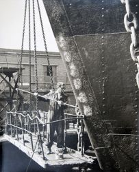 Painting vessel in dry dock